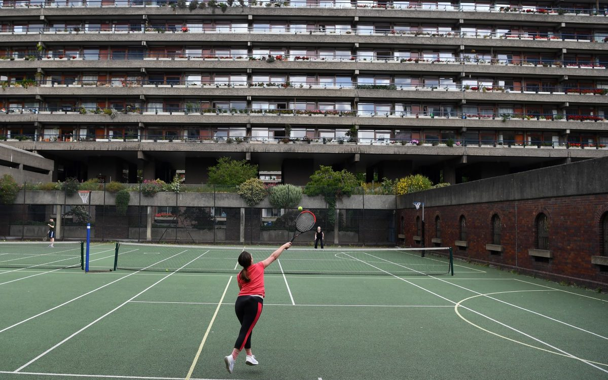 Residents play tennis on the Barbican estate courts May 16, 2020 in London, England . The prime minister announced the general contours of a phased exit from the current lockdown, adopted nearly two months ago in an effort curb the spread of Covid-19
