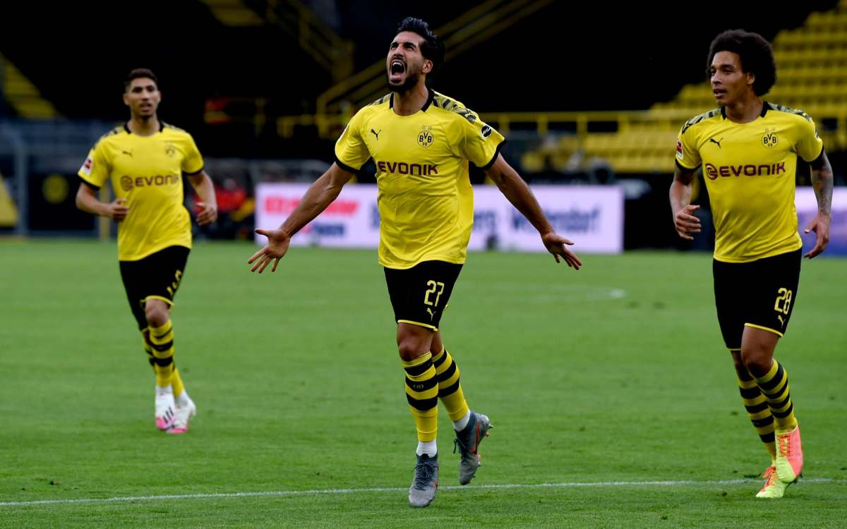 Emre Can (C) of Borussia Dortmund celebrates after scoring his team's first goal with his teammates Axel Witsel (R) and Achraf Hakimi (L) of Borussia Dortmund during the Bundesliga match between Borussia Dortmund and Hertha BSC at Signal Iduna Park on June 06, 2020 in Dortmund, Germany.