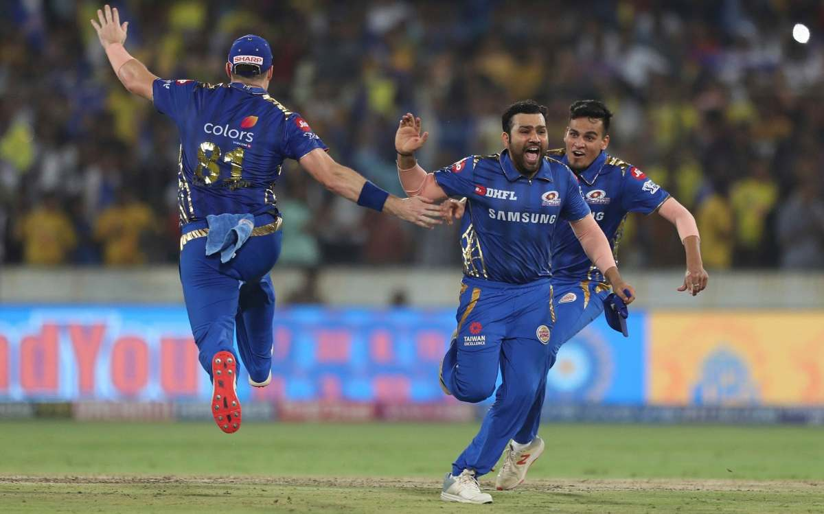 Mumbai Indians captain Rohit Sharma, second right, and teammates celebrate their win in the VIVO IPL T20 cricket final match between Mumbai Indians and Chennai Super Kings in Hyderabad, India, Sunday, May 12, 2019