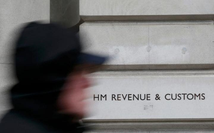 A pedestrian walks past the headquarters of Her Majesty's Revenue and Customs
