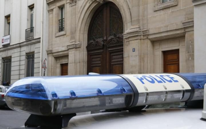 A police car outside the Paris offices of US Internet giant Google in Paris, as police carry out a search as part of a tax fraud investigation.