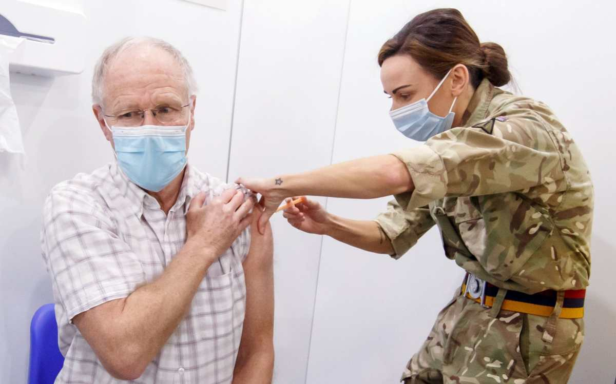 Richard Moss, 73, receives an injection of the the Oxford/AstraZeneca coronavirus vaccine in Leeds on February 8, 2021.
