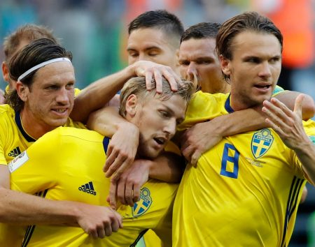 Emil Forsberg celebrates with teammates the opening goal during the round of 16 match between Switzerland and Sweden at the 2018 World Cup