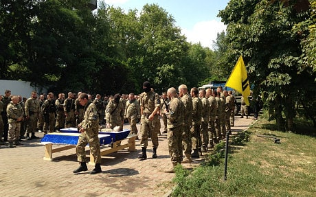 Fighters of the Azov battalion say farewell to their first comrade to die in the war against Russia-backed rebels (Tom Parfitt)