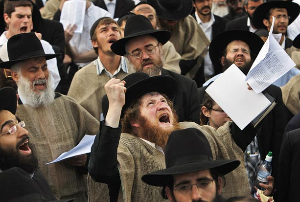 Ultra-Orthodox Jews are seen, wearing mourning sacks, as they demonstrate against a gay pride parade