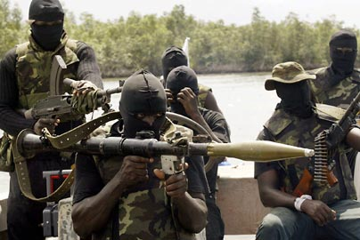 Militants patrol the creeks of  the Niger Delta: Pipeline attack hits Nigeria's crude production