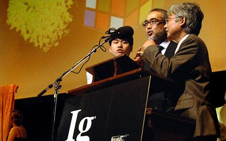 Toshiyuki Nakagaki [centre], of Hokkaido University, Japan and fellow researchers sing their Ig Nobel Prize acceptance speech