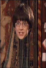 Daniel Radcliffe as Harry Potter using his invisibility cloak