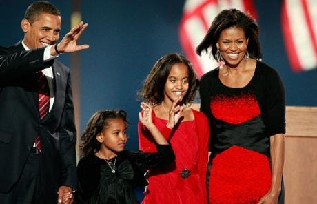 President elect Barack Obama walks on stage, with his wife Michelle  and daughters Malia and Sasha