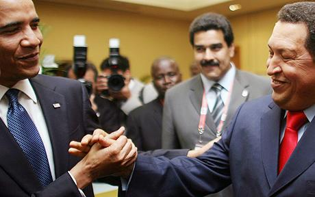Barack Obama exchanges a friendly handshake with Venezuelas President Hugo Chavez  Photo: AP