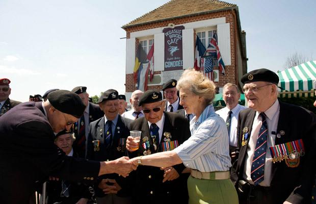 Veterans meet Arlette Gondree at the Gondree Cafe. As a young girl she was in the first house to be captured by the British Forces when capturing what is now the Pegasus Bridge