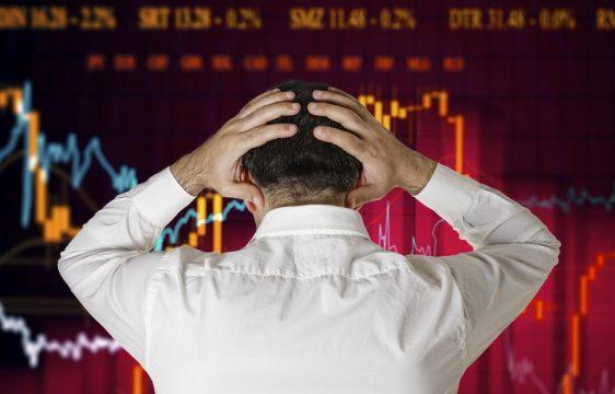 Man broker stock market crash crisis concept