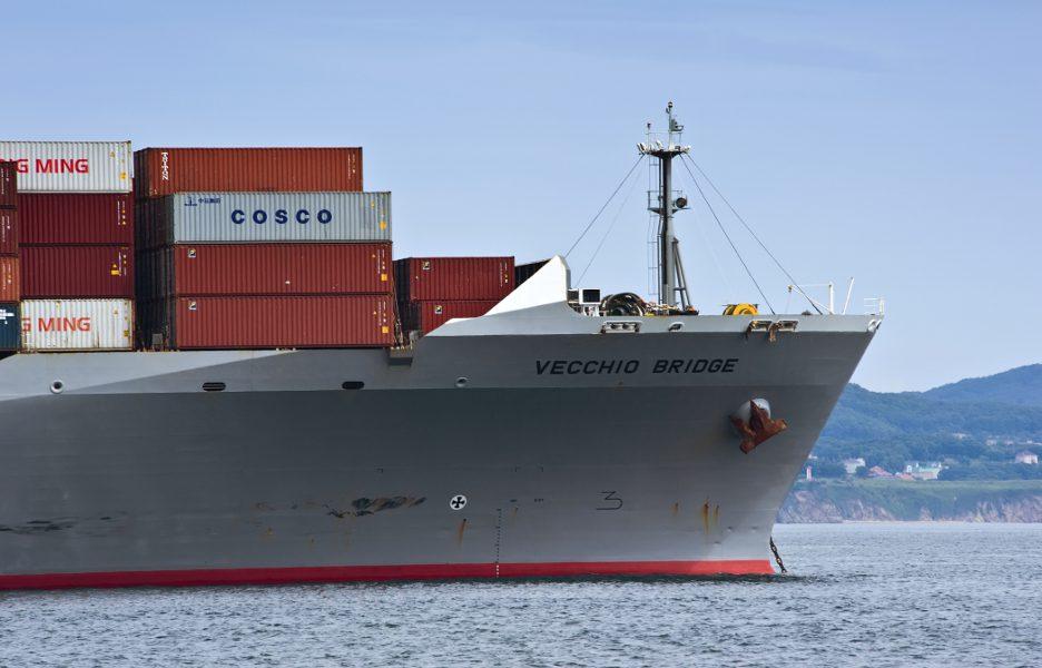 The bow of a huge container ship Vecchio Bridge at anchored in the roads navio cargueiro container barco mar porto importacao exportacao . Nakhodka Bay. East (Japan) Sea. 02.08.2015