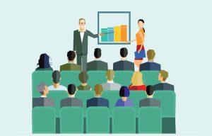 TeleSintese-apresentacao-reuniao-treinamento-curso-grafico-resultado-positivo-plateia-pessoas