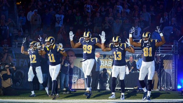 St. Louis Rams wide receiver Stedman Bailey (12) and wide receiver Tavon Austin (11) and tight end Jared Cook (89) and wide receiver Chris Givens (13) and wide receiver Kenny Britt (81) put their hands up to show support for Michael Brown before a game against the Oakland Raiders at the Edward Jones Dome. (Jeff Curry-USA TODAY Sports)
