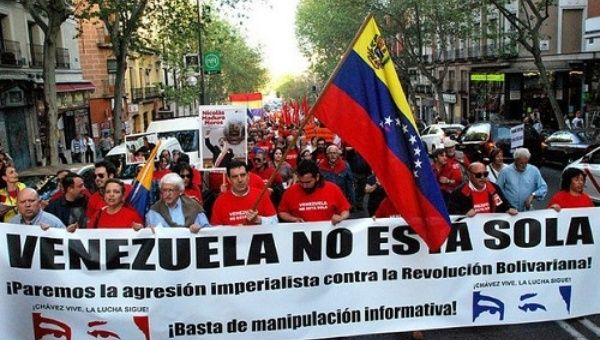 "A banner reads ""Venezuela is not alone"" on a demonstration in Spain in 2014"