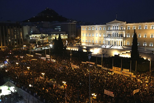 People gather in front of the parliament during an anti-austerity and pro-government demonstration in Athens February 15, 2015.
