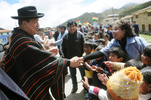 President Chavez greets people in the city of Cochabamba, Bolivia during one of his visits. Chavez built close ties with Bolivia following the election of Evo Morales as Bolivian president, and Venezuelan officials provided technical support to Bolivia when the country decided to nationalize its energy sector.