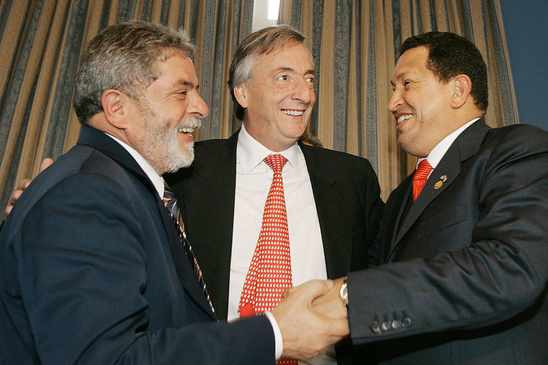 Brazilian President Lula da Silva (L), late Argentine President Nestor Kirchner (C) and President Chavez meet in Montevideo during the Mercosur summit. The three leaders were key to rejecting the U.S.-led Free Trade Agreement of the Americas (FTAA) proposal in 2005.