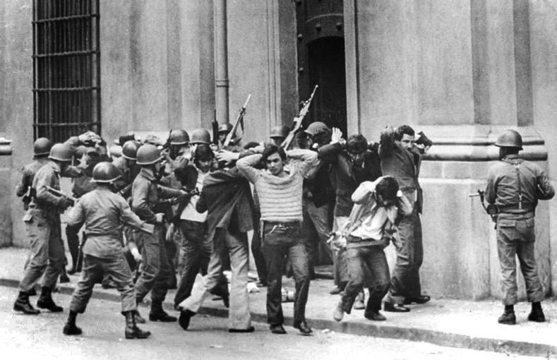 "According to the CIA ""the consensus at the highest levels of the US Government was that an Allende Presidency would seriously hurt US national interests (in Chile)."" In this photo, Supporters of President Salvador Allende are rounded up by General Augusto Pinochet"