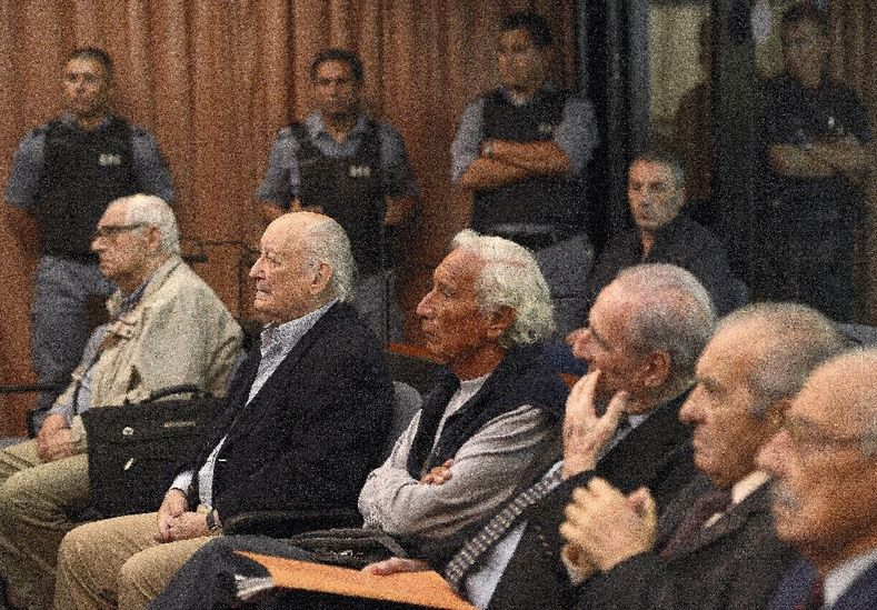 Former Argentine military members Santiago Riveros (2-L) and Eugenio Guanabens (C) are seen in Buenos Aires in 2013 among other defendants during their trials over crimes committed during Operation Condor.