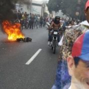 A man holds a poster of Henrique Capriles in protest of Maduro