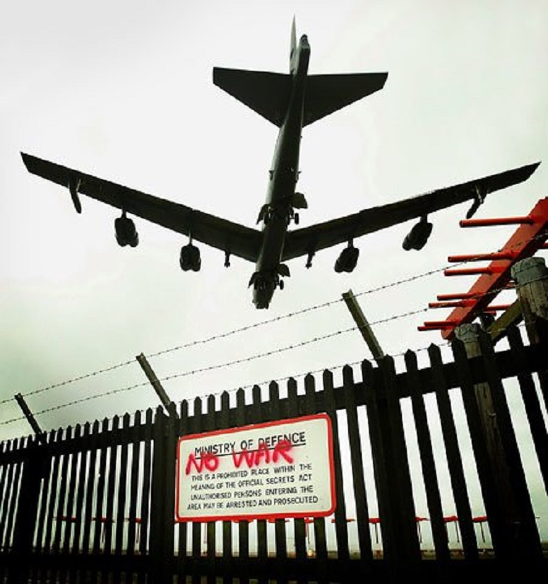 A U.S. B-52 bomber crosses the perimeter fence at Fairford RAF base in Gloucestershire.