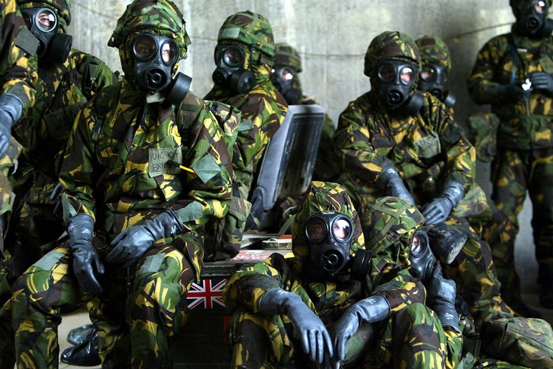 British Royal Air Force personnel wait in a bunker wearing full Nuclear Biological and Chemical suits after a warning of a Scud missile attack on their base in Kuwait March 20, 2003.