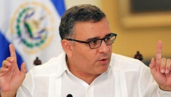 Mauricio Funes sits during a press conference.