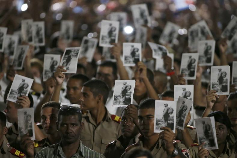 Cadets hold images of Cuba