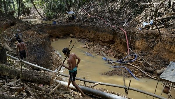 Yanomami Indians in an illegal gold mine in the heart of the Amazon rainforest, Roraima state, Brazil