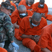 Detainees on arrival to Camp X-Ray, the holding facility at Guantanamo Bay, Cuba.