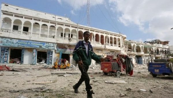A Somali government soldier walks near the scene of an explosion in front of Dayah hotel in Somalia