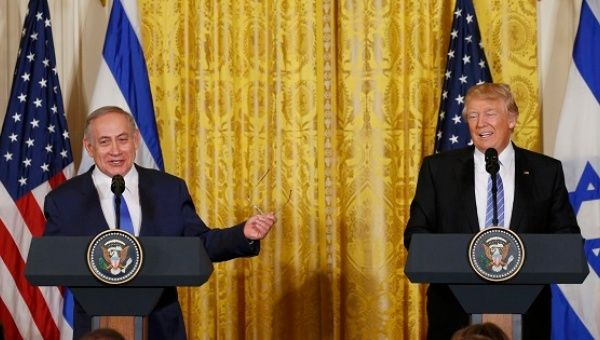 U.S. President Trump laughs with Israeli Prime Minister Netanyahu at a joint news conference at the White House in Washington.