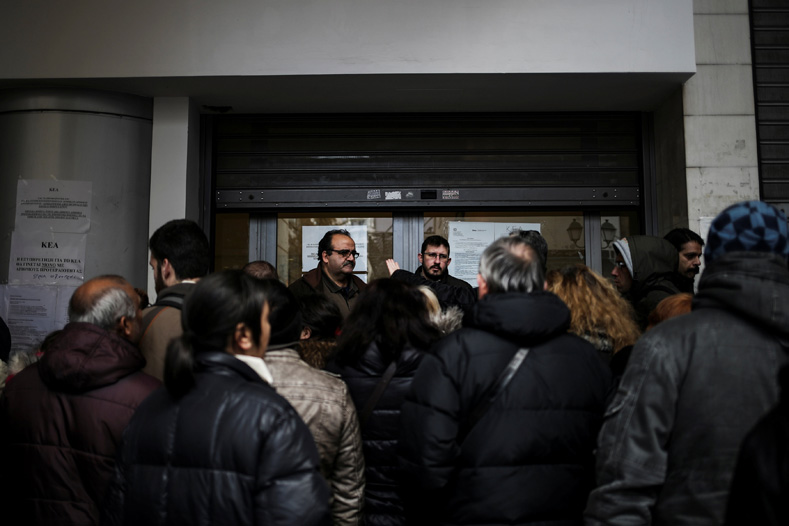 People line up to apply for a social benefit from the Directorate of Social Welfare and Health of the Municipality of Athens, Greece, Feb. 14, 2017.