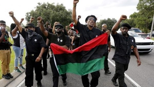 Demonstrators wearing the insignia of the New Black Panthers Party protest the shooting death of Alton Sterling in Baton Rouge, July 9, 2016.