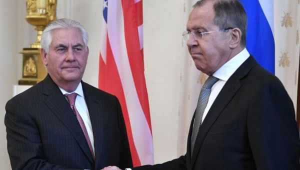 Russian Foreign Minister Sergei Lavrov (R) shakes hands with U.S. Secretary of State Rex Tillerson in Moscow.