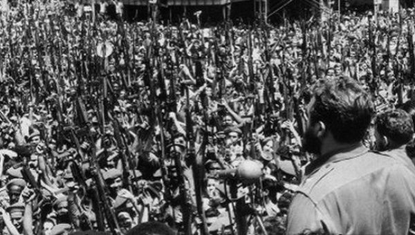 The Cuban people raise their rifles in defense of Fidel Castro