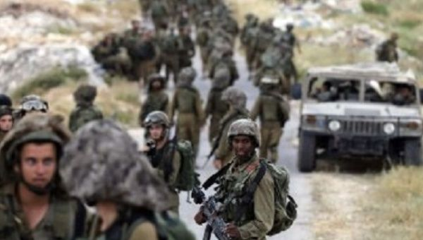 Israeli soldiers patrol near the West Bank City of Hebron.