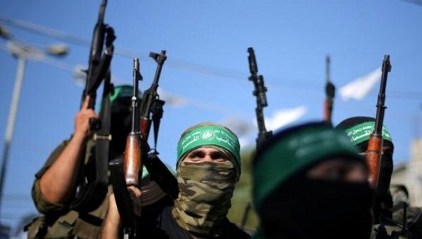 Hamas militants hold weapons as they celebrate the release of Palestinian prisoner Mohammed al-Bashiti, Gaza Strip, July 25, 2016.