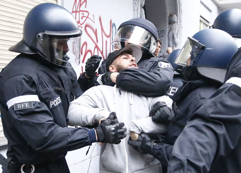 German riot police detains a demonstrator during a demonstration of leftists at May Day demonstrations in Berlin, Kreuzberg dirstict, Germany, May 1, 2017.