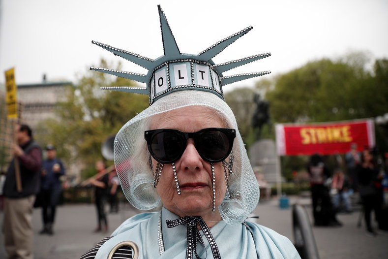 A woman stands dressed as the Statue of Liberty during a May Day protest in New York, U.S. May 1, 2017.