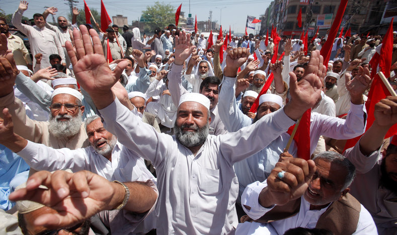 Labourers and political workers take part in a rally demanding reasonable wages and workers