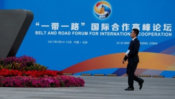 A man walks past the China National Convention Center, a venue of the upcoming Belt and Road Forum in Beijing, China, on May 12, 2017.