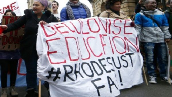 A group of South African students in the United Kingdom march to demand the removal of Rhodes