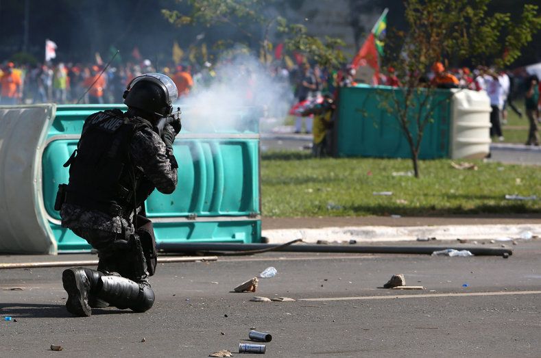 Riot police fire tear gas at the anti-Temer protesters.