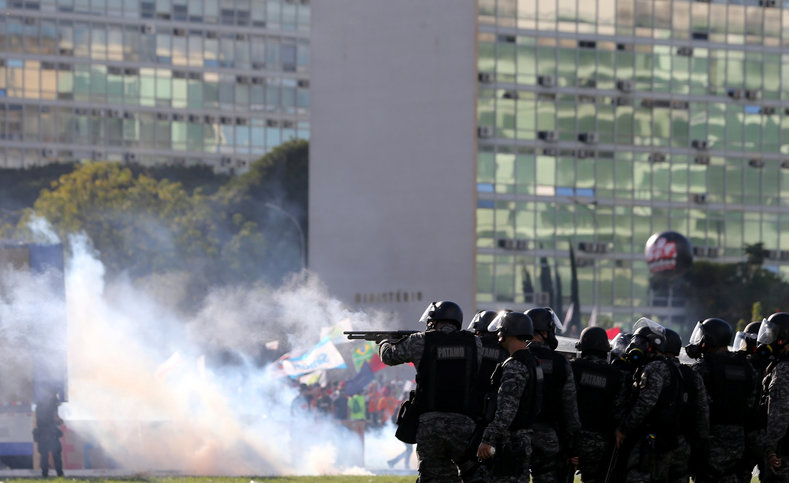 Riot police officers clash with demonstrators.
