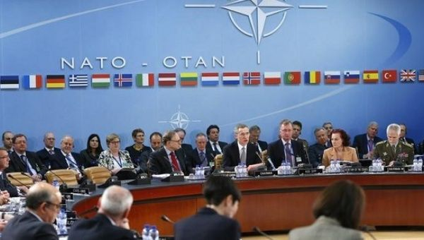 NATO Secretary General Jens Stoltenberg (C) addresses a NATO defense ministers meeting at the Alliance