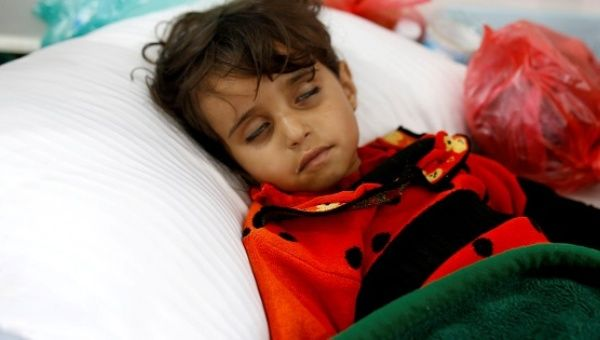 A girl infected with cholera lies on the ground at a hospital in Sanaa.