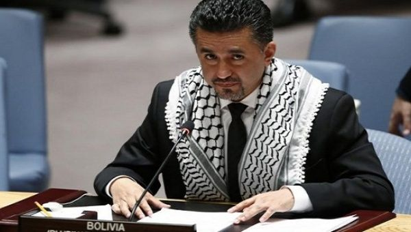 Sacha Llorenti addresses the Security Council in 2014 wearing the Palestinian keffiyeh, a symbol of resistance.